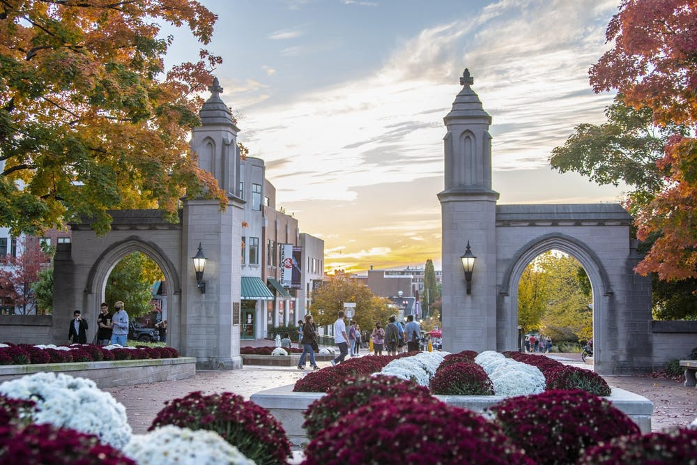 <p>The sun sets Oct. 10, 2020, behind the Sample Gates. The three executive tickets for IU Student Government met to discuss their campaigns Tuesday.</p>