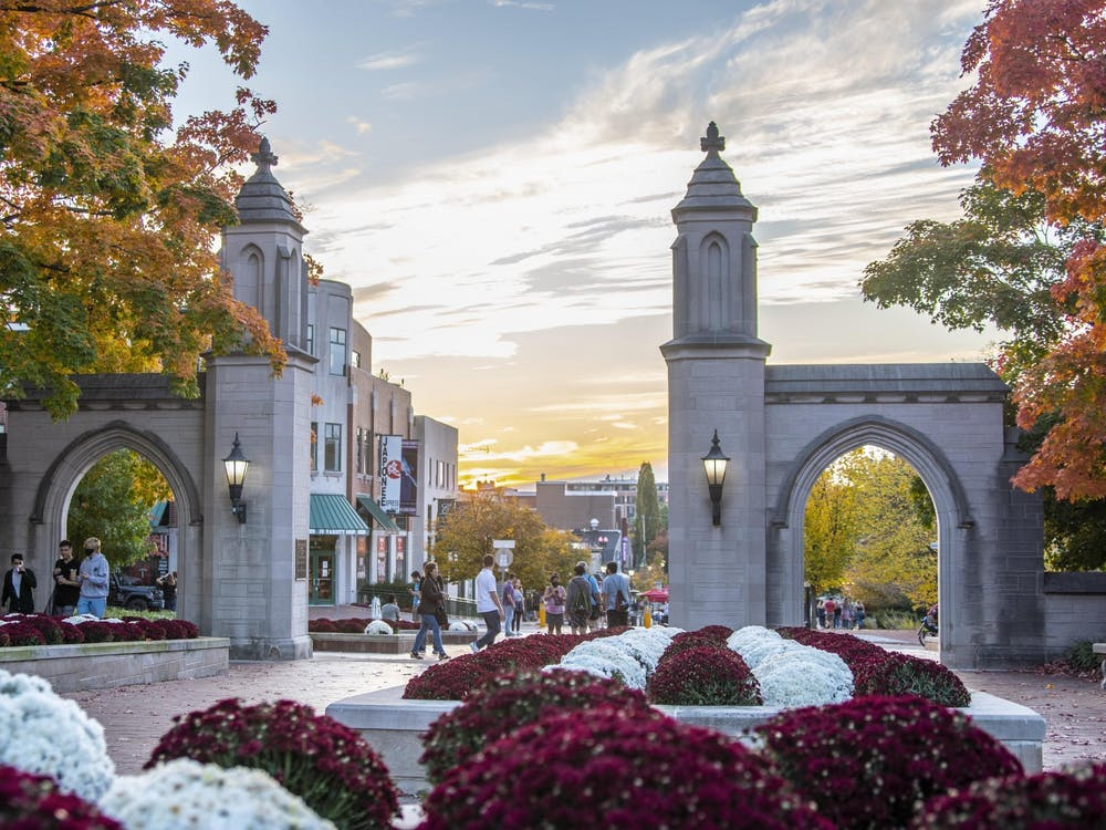 The sun sets Oct. 10, 2020, behind the Sample Gates. The three executive tickets for IU Student Government met to discuss their campaigns Tuesday.