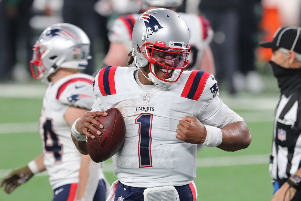 <p>Cam Newton reacts after scoring a game-tying touchdown for the New England Patriots during the second half against the New York Jets on Nov. 9, 2020, at MetLife Stadium in East Rutherford, New Jersey.</p>