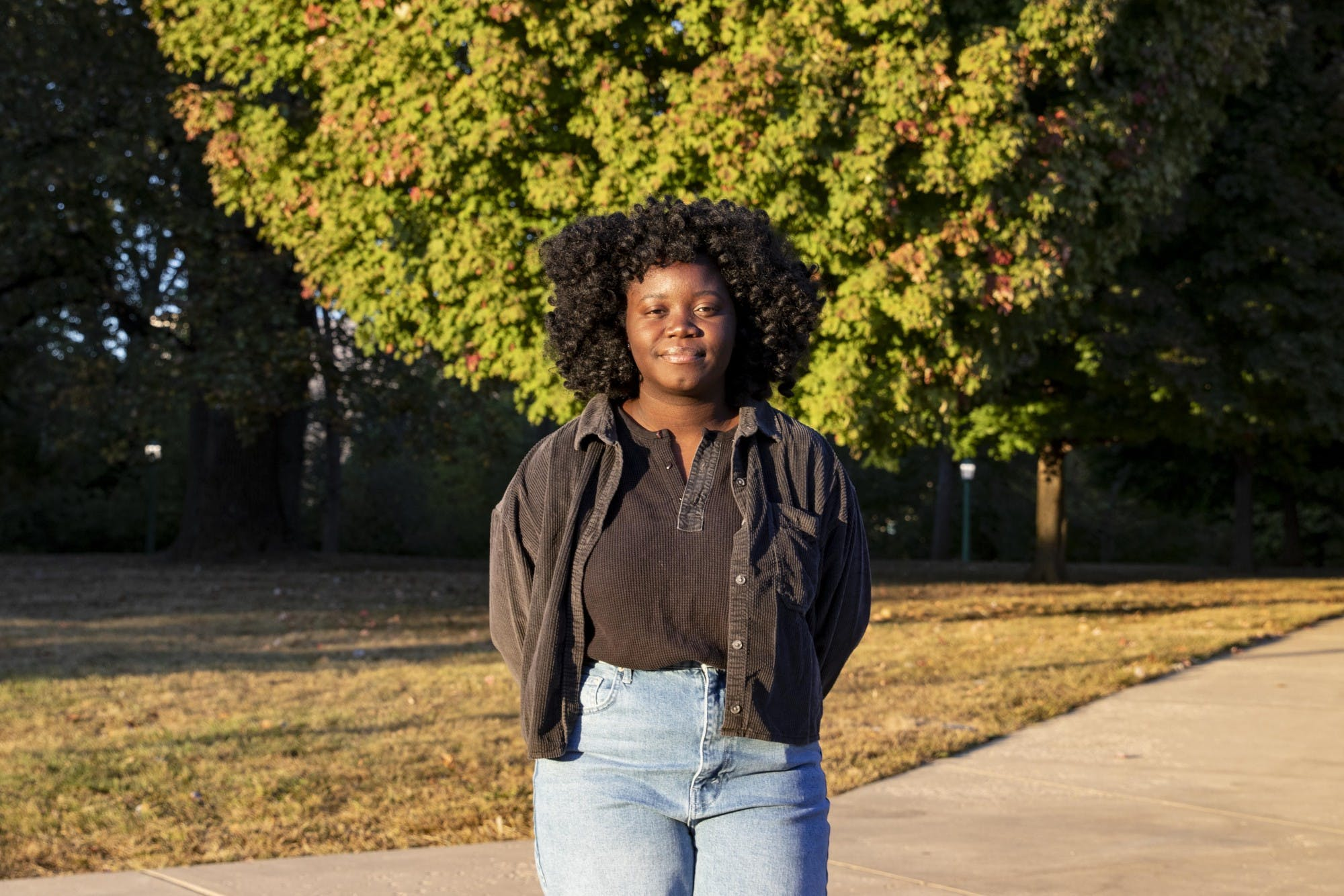Junior Massa Massa Massaley stands in the sun Oct. 5in Bloomington, Indiana. Massaley is a Black student at IU and has experienced acts of bias alongside her best friend Alice Aluko.