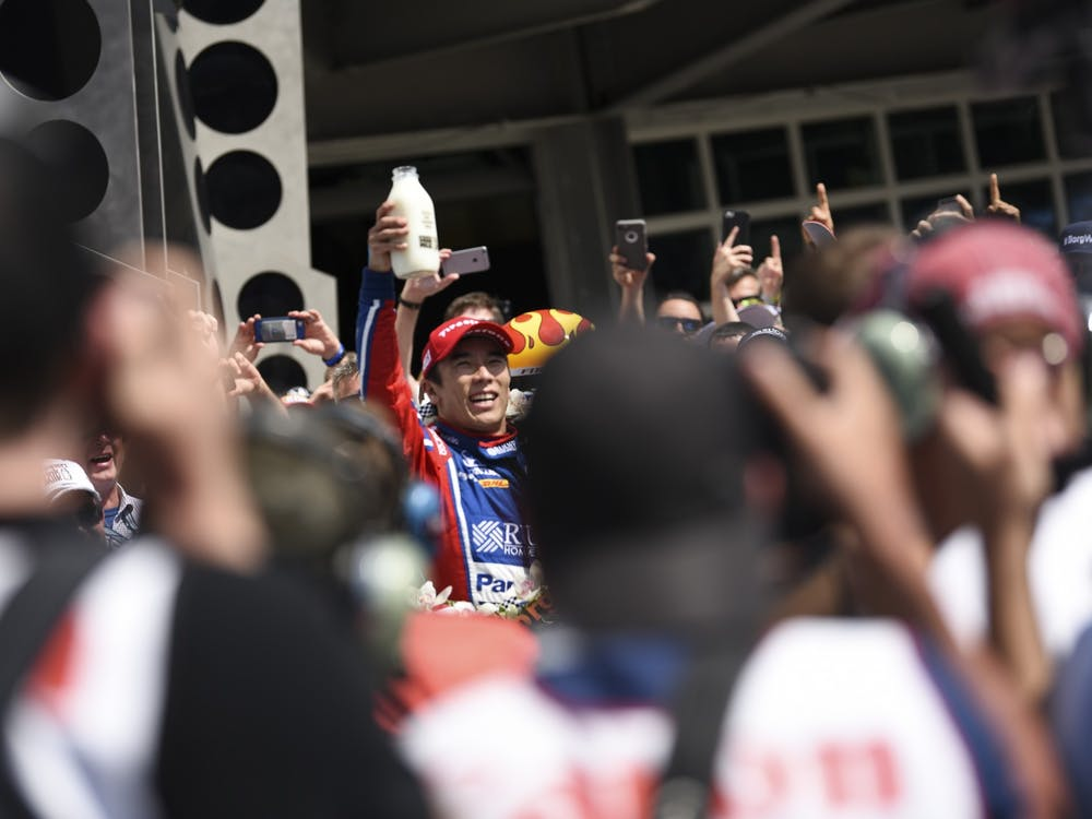Takuma Sato holds up the ceremonial milk after winning the 101st Indianapolis 500 on May 28, 2017. Sato won the 104th Indianapolis 500 on Sunday, his second win in the race.