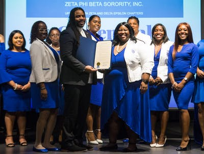 Members of Zeta Phi Beta hold a proclamation Jan. 16 signed by Mayor John Hamilton in the Monroe County Public Library. The proclamation declared Jan. 16, 2020, to be Zeta Phi Beta Sorority, Incorporated Day.