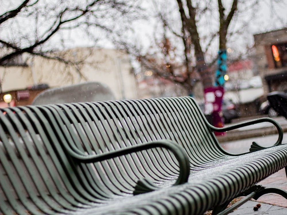 A park bench sits with hostile architecture in Peoples' Park. Hostile architecture, otherwise known as anti-homeless architecture, is designing objects to prevent sleeping on the park benches.
