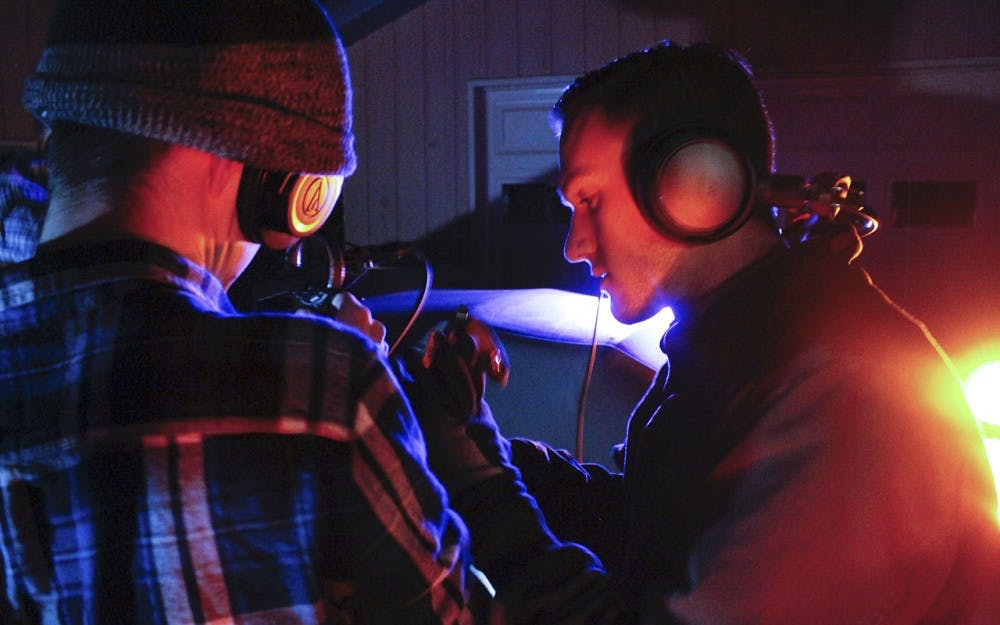 "Garrett Goad and Andrew Torbenson collaborate to record audio on the set of ""Repopulate""."