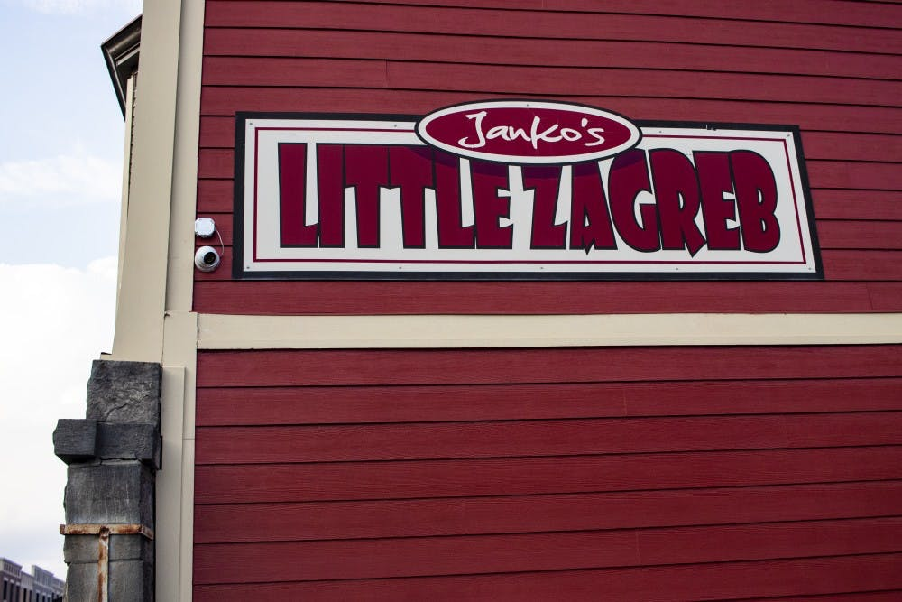 <p>A Janko's Little Zagreb sign hangs outside of the restaurant  Sept. 25 on Sixth Street. The restaurant serves steak and seafood dinners.</p>