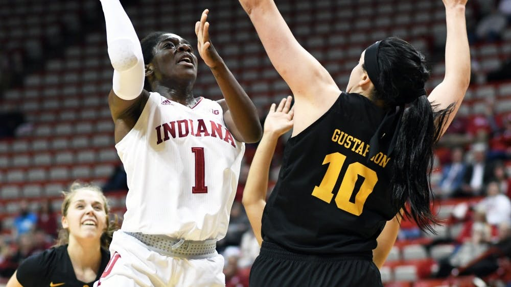Sophomore guard Bendu Yeaney drives to the basket during the game against Iowa on Feb. 21 in Simon Skjodt Assembly Hall. Yeaney scored the game-winning basket in IU's 75-73 win over Iowa.