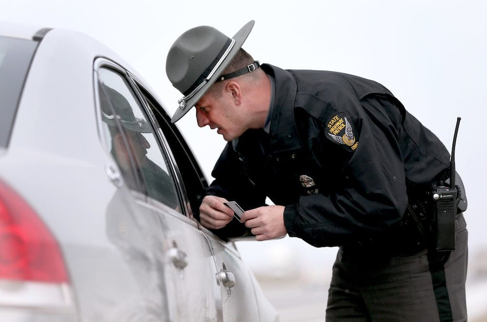 <p>Ohio Highway Patrol trooper John Williams speaks to a driver he pulled over for speeding Jan. 20 on the Ohio Turnpike. Indiana State Police will launch an initiative called &quot;Full Court Press&quot; in March that aims to crack down on speeding.  </p>