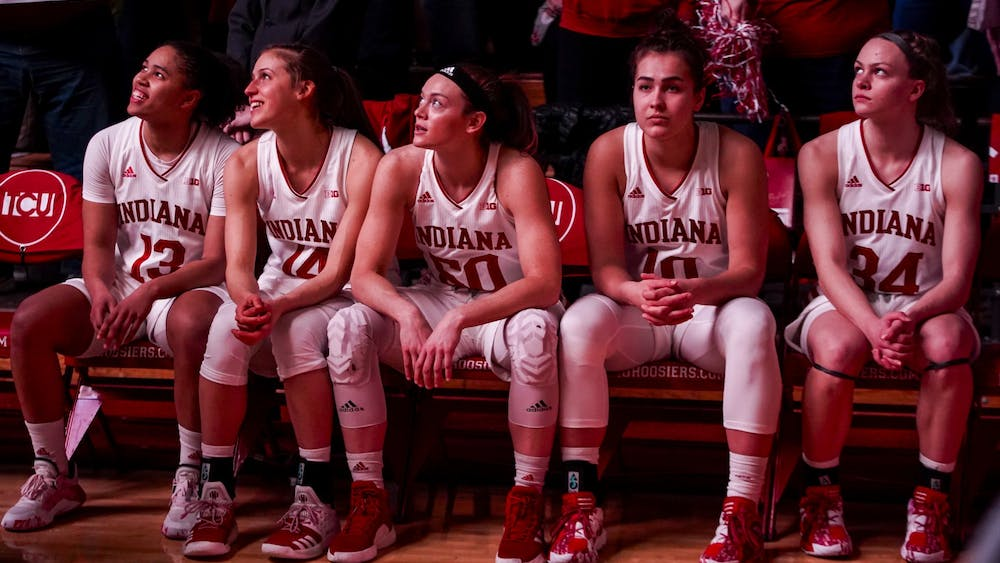 The IU women's basketball starting lineup sits and watches the opening video Feb. 16 at Simon Skjodt Assembly Hall. IU fell from No. 20 to No. 24 in Monday's AP Poll.
