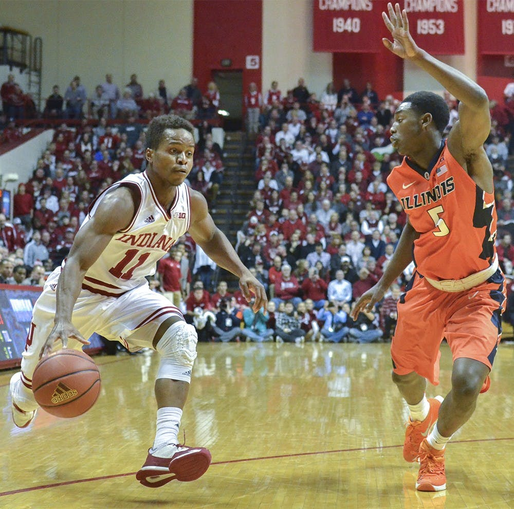 """Senior guard Kevin """"Yogi"""" Ferrell takes the ball down the court against Illinois on Tuesday at Assembly Hall. The Hoosiers won 103-69."""
