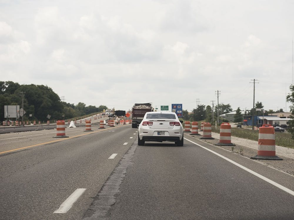 Safety cones and signs line section five of State Road 37 on Aug. 16, 2017.