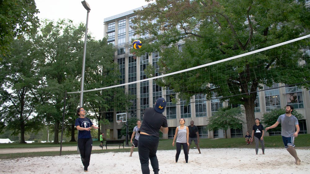 Students play volleyball Aug. 31 on the courts outside Tulip Tree Apartments. RPS plans to allow its residents in unfurnished apartments to stay throughout their contract periods as usual, said Tim Stockton, associate director of apartment housing at RPS.