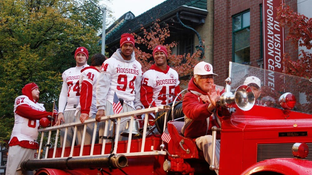 IU footbal players ride on a classic fire truck during the 2009 the homecoming parade.