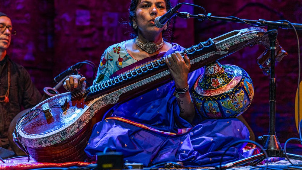 Saraswathi Ranganathan leads the audience through a meditation exercise Sept. 25, 2021, on the stage of the Buskirk-Chumley Theater. The performance was part of the 28th annual Lotus World Music and Arts Festival.
