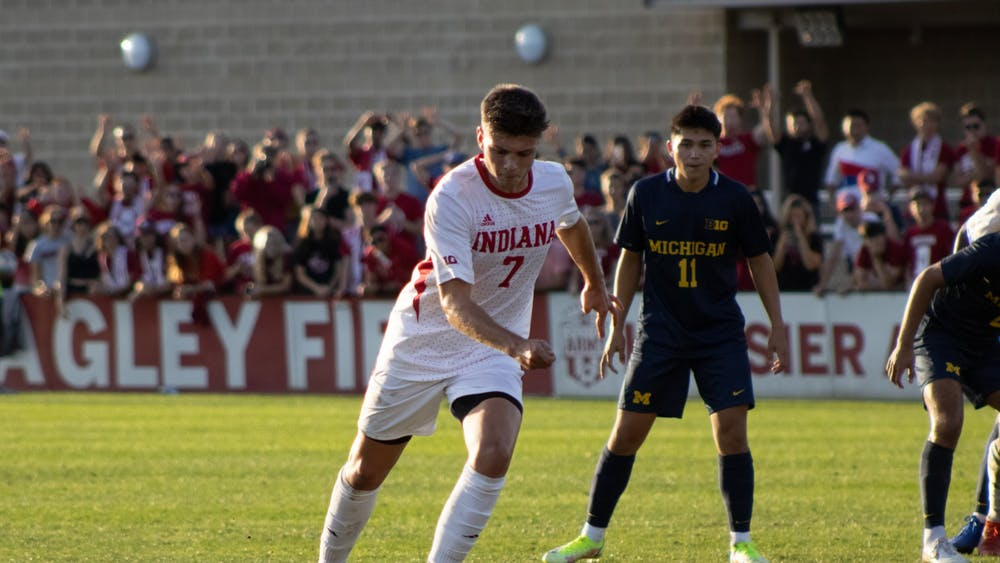 Junior forward Victor Bezerra takes a shot against the University of Michigan on Oct. 1, 2021. Bezerra scored one of Indiana's two goals against the University of Evansville on Wednesday.