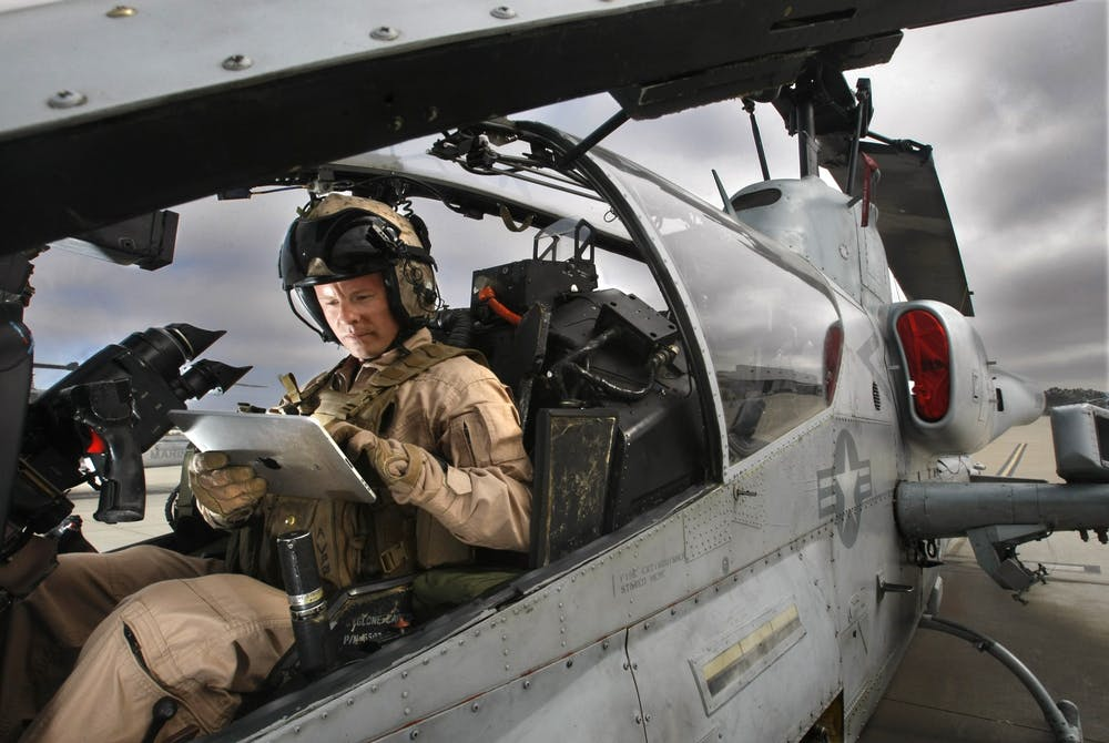 <p>At the Marine Corps Air Station Camp Pendleton, Captain Jim Carlson sits in his Super Cobra attack helicopter with an iPad computer, September 1, 2011. The United States Military conducted training last night in Bloomington from 7 p.m. to 3 a.m., including the flying of military helicopters.</p>