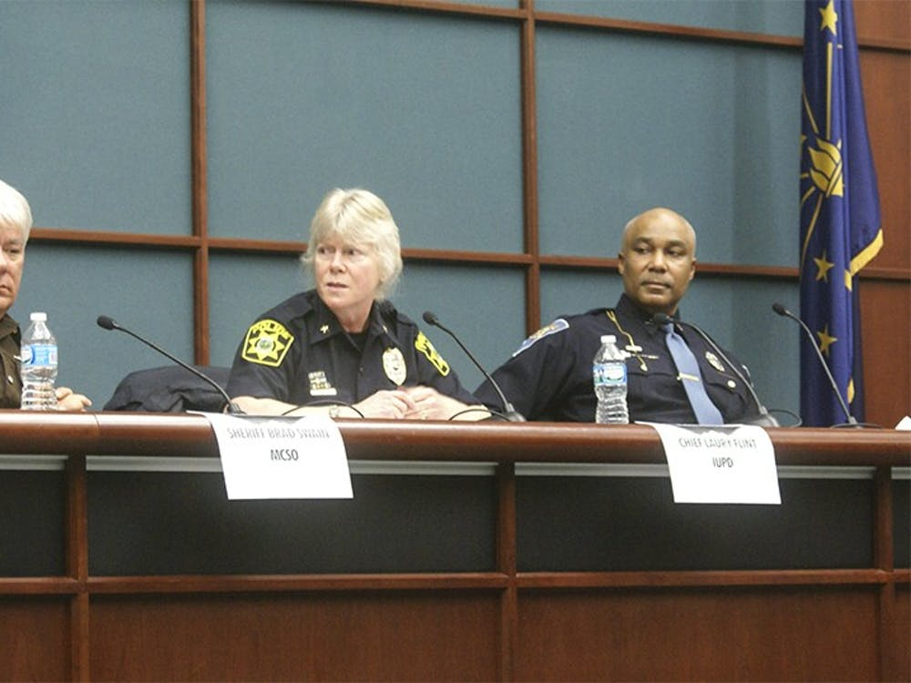 Members of Bloomington's law enforcement community respond to questions from the community on Thursday. The Safe and Civil City Program initiated a police forum between police officers and civillians as a chance to foster trust.