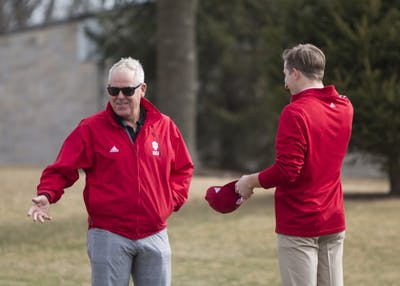 Coach Mike Mayer talks to freshman Evan Yakubov during practice at the IU Golf Course in Jan. 2018. Mayer has been the head coach of IU men's golf for 21 seasons.