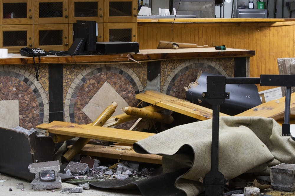 """<p>Debris sits in front of a counter Sept. 1 in Trailhead Pizzeria. """"It was really kind of special,"""" owner Mark Bell said, when discussing the destroyed mosaic artwork on the front of the counter.</p>"""