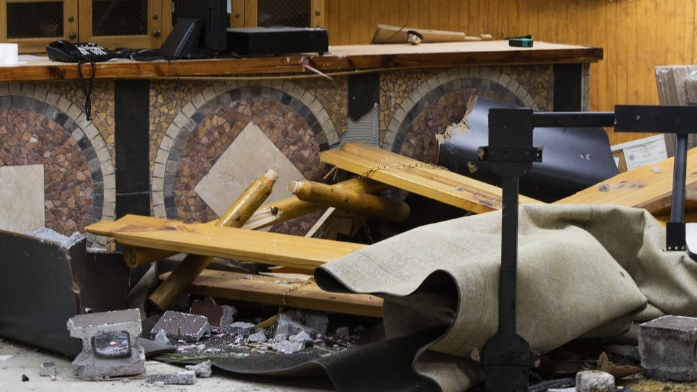"""Debris sits in front of a counter Sept. 1 in Trailhead Pizzeria. """"It was really kind of special,"""" owner Mark Bell said, when discussing the destroyed mosaic artwork on the front of the counter."""