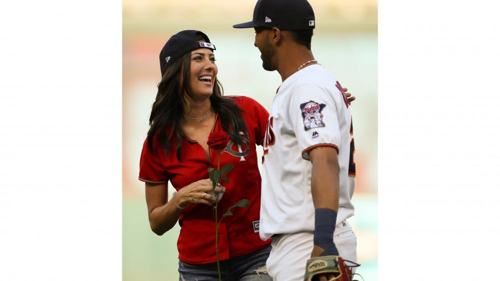 Minnesota Twins left fielder Eddie Rosario surprised the Bachelorette, Becca Kufrin, with a rose after he caught her ceremonial first pitch before a game against the Kansas City Royals on July 10, 2018, at Target Field in Minneapolis.