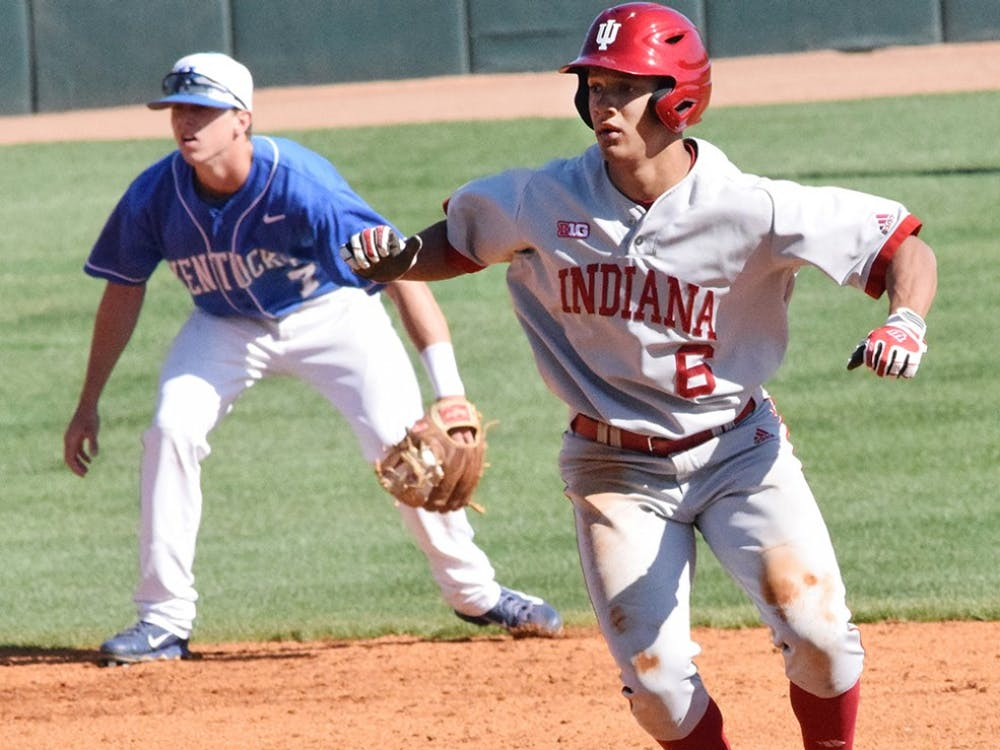 Indiana infielder Isaiah Pasteur (6) attempts to steal a base during the game against Kentucky on Tuesday, March 31, 2015 in Lexington, Ky. Indiana won 11-7.