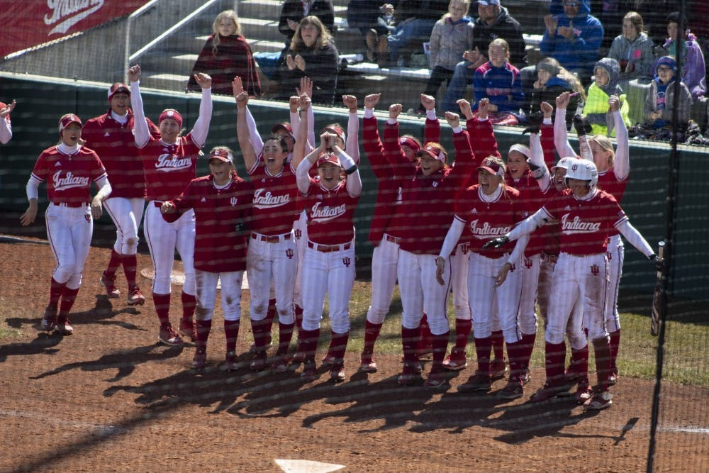 <p>The IU softball team awaits then sophomore, now junior Grayson Radcliffe on March 17, 2019, after she hits a grand slam against Saint Francis University. IU softball incoming freshman catcher Grace Lorsung recorded a .485 career batting average with 114 RBI, 121 runs scored and 25 home runs in three seasons for Cathedral High School in Indianapolis.</p>