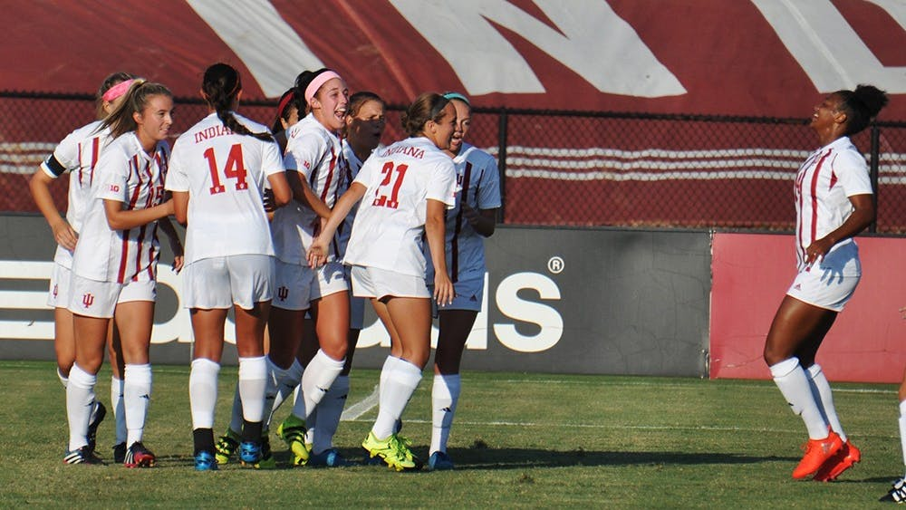 The IU women's soccer team celebrate an early goal in their season-opening game against Louisville on Sept. 24 at Bill Armstrong Stadium.