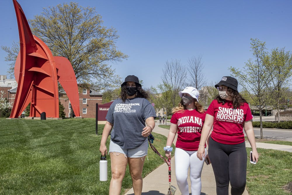 <p>Freshmen Isabella Lohr, Anna Pockrass and Kathleen Simunek, left to right, enjoy the springtime weather Wednesday near the Musical Arts Center.<strong> </strong>Indiana lawmakers are considering an amendment to Senate Bill 414 that would require reports from college campuses on student perspectives of free speech.</p>
