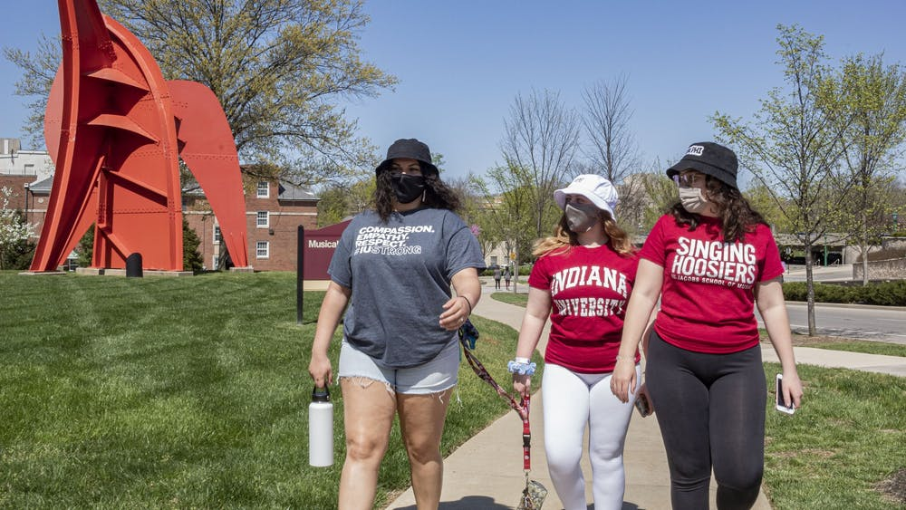 Freshmen Isabella Lohr, Anna Pockrass and Kathleen Simunek, left to right, enjoy the springtime weather Wednesday near the Musical Arts Center. Indiana lawmakers are considering an amendment to Senate Bill 414 that would require reports from college campuses on student perspectives of free speech.