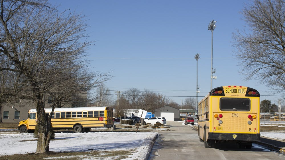 School buses leave the Bloomington High School South parking lot on Jan. 29 during student dismissal. The Monroe County Community School Corporation moved to phase green Monday, allowing students to attend school in person five days a week.