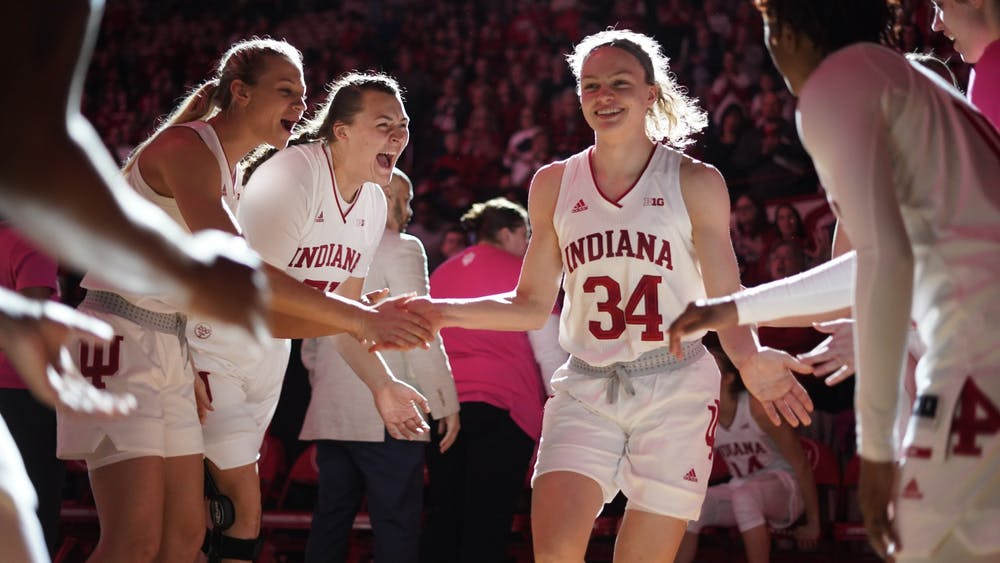 Then-sophomore Grace Berger is cheered on by her teammates after joining the starting line-up Feb. 27, 2020, at Simon Skjodt Assembly Hall. IU was scheduled to play Rutgers on Jan. 18 but has rescheduled the game for Feb. 4 at Simon Skjodt Assembly Hall.