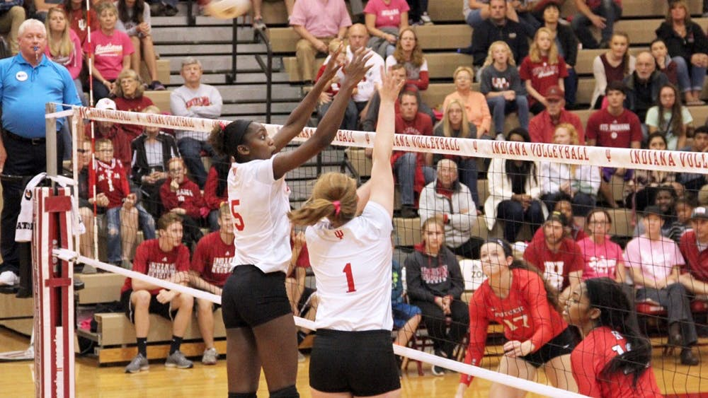 Jazzmine McDonald (left) and Victoria Brisack defend the ball as they compete against Rutgers Scarlet Knight Friday night at the University Gym.