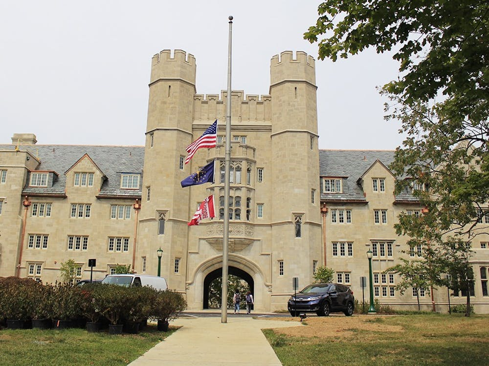 Flags fly at half-staff Monday outside of Wells Quad for the anniversary of 9/11. In 2001, 2,977 victims died in the attacks.