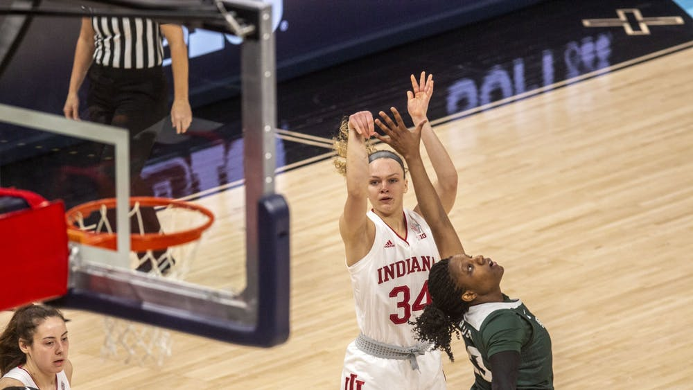 Junior guard Grace Berger attempts a shot Thursday in the quarterfinals of the Big Ten women's basketball tournament at Bankers Life Fieldhouse in Indianapolis. No. 2 seed IU led No. 7 seed Michigan State at halftime 34-26.