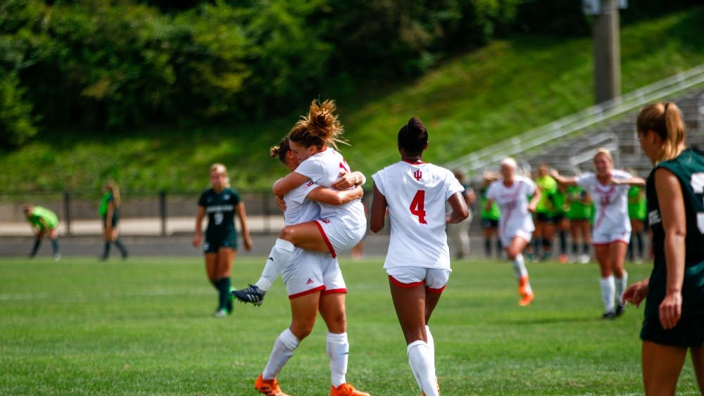 Sophomore Melanie Forbes, senior Annelie Leitner and senior Mykayla Brown celebrate after Forbes' goal Sept. 16 at Bill Armstrong Stadium. IU won against Michigan State, 3-0.