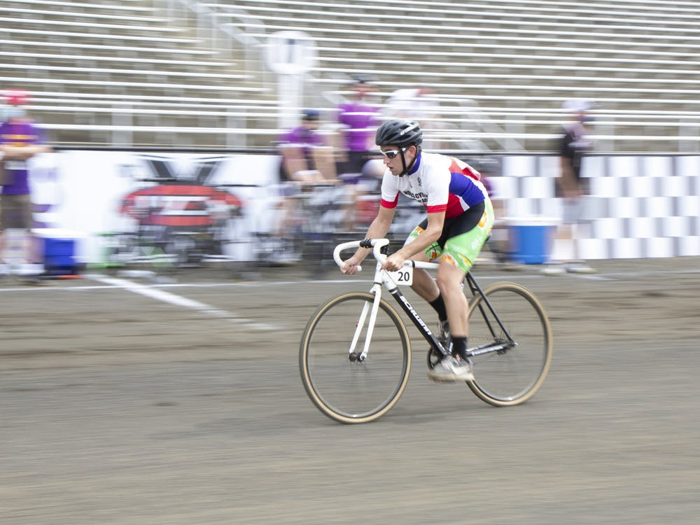 A Novus Cycling rider races on the track during the Men's Little 500 on Wednesday at Bill Armstrong Stadium.