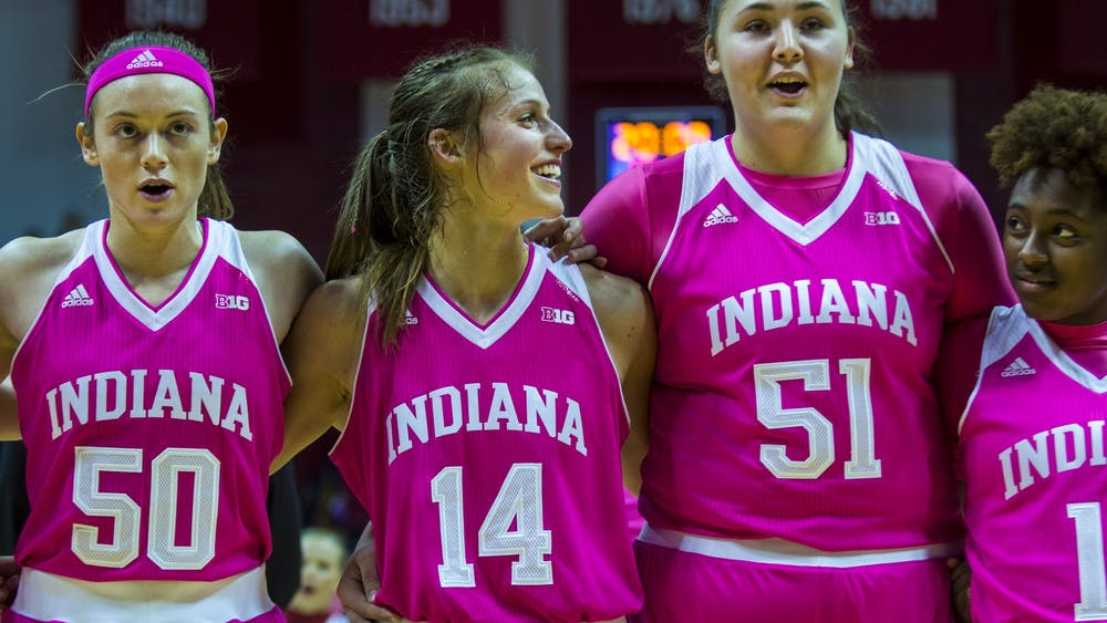 The IU women's basketball team sings along to the IU alma mater with the rest of the women's basketball team Jan. 30 after defeating Wisconsin in Simon Skjodt Assembly Hall. IU advanced to No. 18 following back-to-back victories at home.