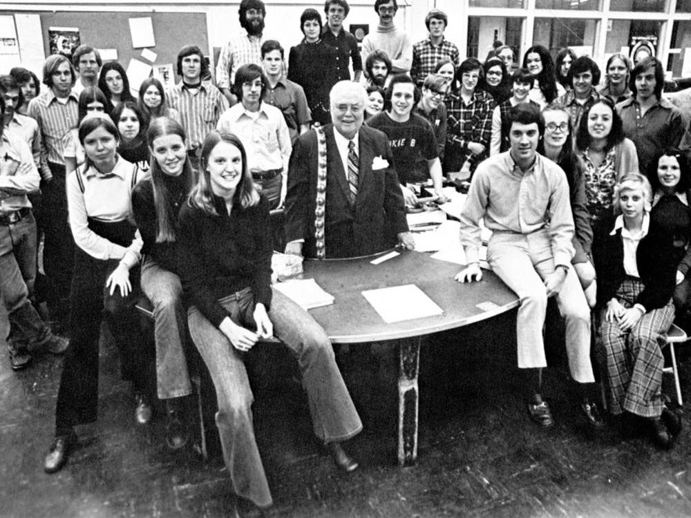 Paul Tash, a former editor-in-chief of the Indiana Daily Student, poses in a photo with Herman B Wells and the 1974 staff of the IDS. Tash will give the 2018 undergraduate commencement address May 5.