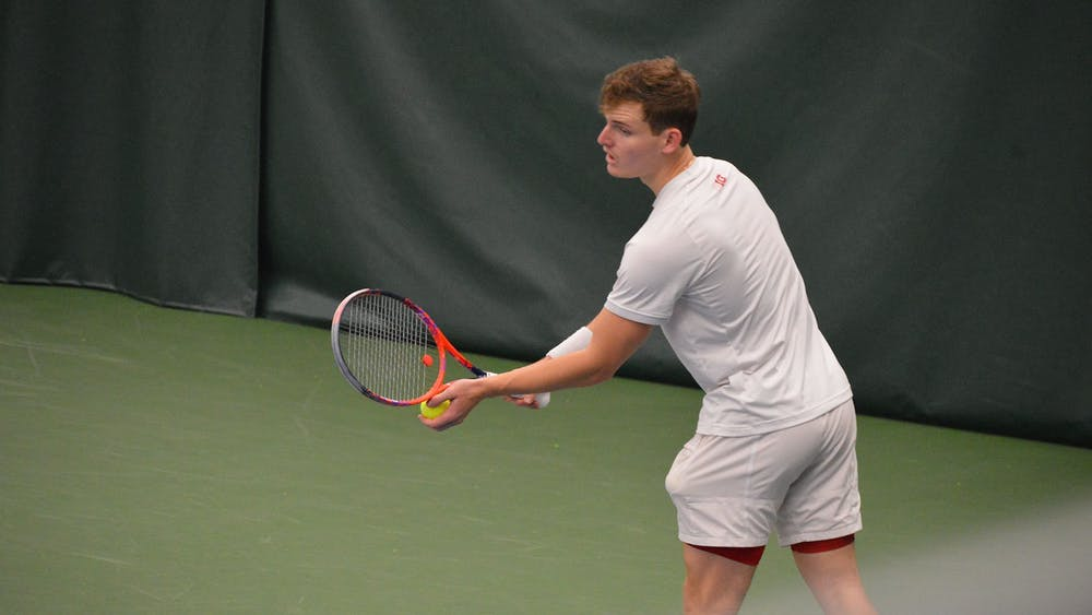 Senior Andrew Redding prepares to serve the ball April 11 at the IU Tennis Center. The IU men's tennis team will compete against Wisconsin in the Big Ten Tournament on Thursday in Lincoln, Nebraska.