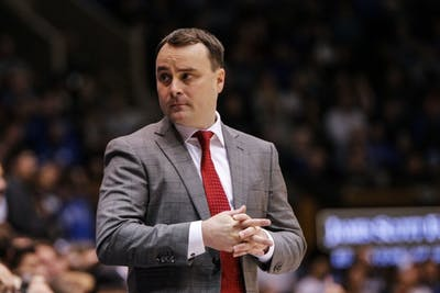 IU Coach Archie Miller listens to the assistant coach on the sidelines of Cameron Indoor Stadium on Nov. 27 against Duke University. The basketball program announced Thursday that Mike Roberts, who played from 2001-2005 for IU, would be joining Miller's coaching staff.