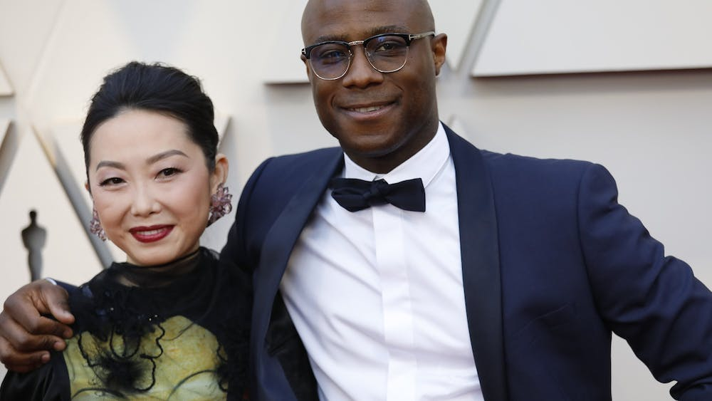 """Barry Jenkins, right, and a guest arrive at the 91st Academy Awards on Feb. 24, 2019, at the Dolby Theatre at Hollywood & Highland Center in Hollywood, California. Jenkins, who directed """"Moonlight,"""" has signed on to direct a sequel to the 2019 remake of """"The Lion King."""""""