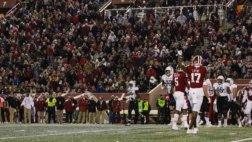 Then-junior defensive back Raheem Layne puts his fist in the air during the second quarter Nov. 2 at Memorial Stadium. IU plans to allow full capacity for the 2021 football season at Memorial Stadium, according to a statement released Friday.