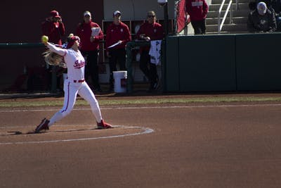 Senior pitcher Tara Trainer throws the opening pitch March 16. IU will play the University of Louisville on March 26.