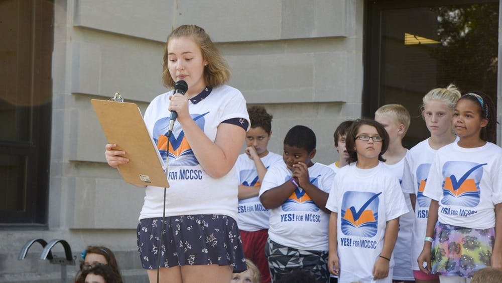 """Zoe Berenstein, junior from the Bloomington South High School, speaks in a Rally, """"Yes For MCCSC needs YOU"""" on Tuesday evening at the Monroe County Courthouse. Berenstein shared how public education helped her improve language."""