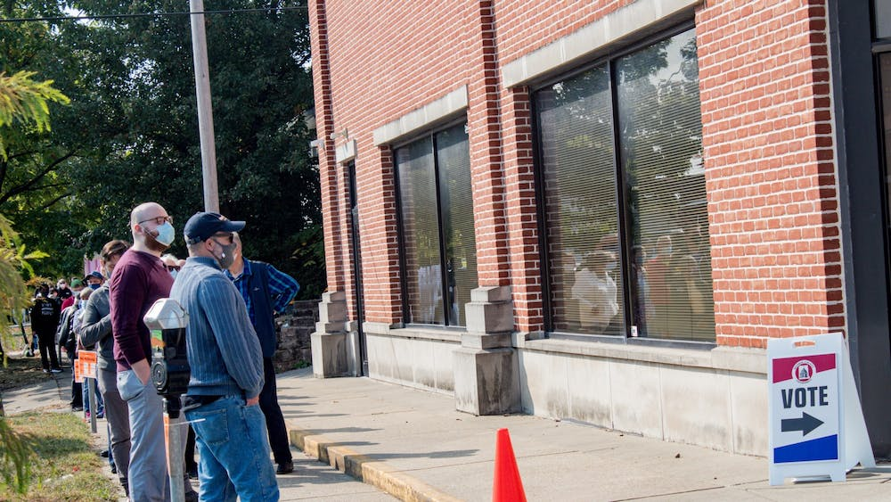 Early voters wait in line to cast their vote Oct. 6, 2020, at 401 W. Seventh St. Five Bloomington organizations will have voter registration drives Sept. 28.