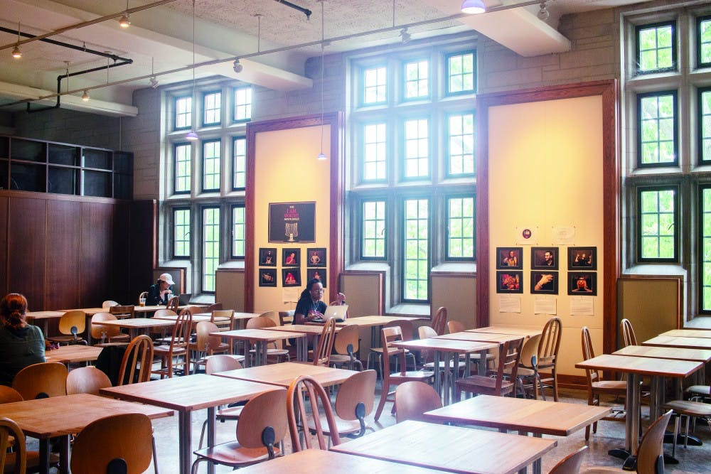Students study at tables in front of Starbucks in the Indiana Memorial Union.