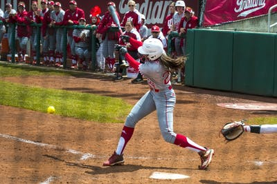 Sophomore Taylor Lambert swings at a pitch during a game against Rutgers on April 28 at Andy Mohr Field. IU lost the game, 5-2.