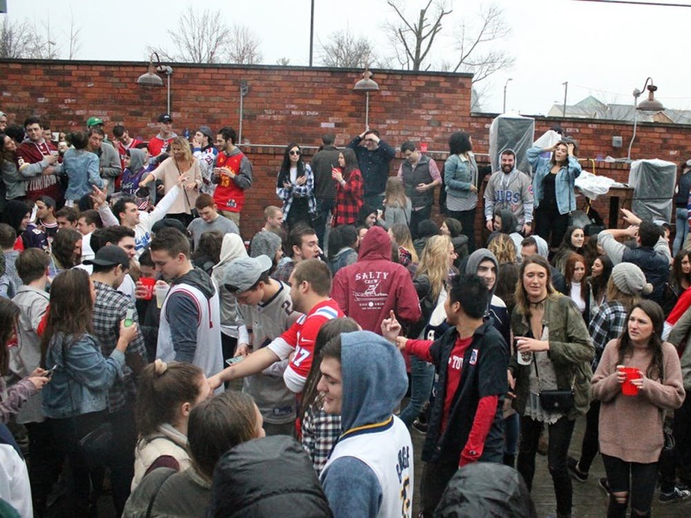 Students outside on the patio at Kilroys on Kirkwood enjoy thier day off from classes Monday afternoon. KOK is popular on Martin Luth King Jr. day because of their unoffical open to close event.