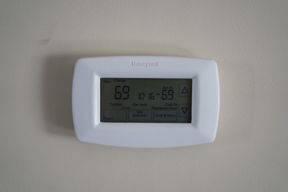 <p>A thermostat displays the temperature Sept. 23 inside a student house. Students often try to find ways of keeping their utility costs down. </p>