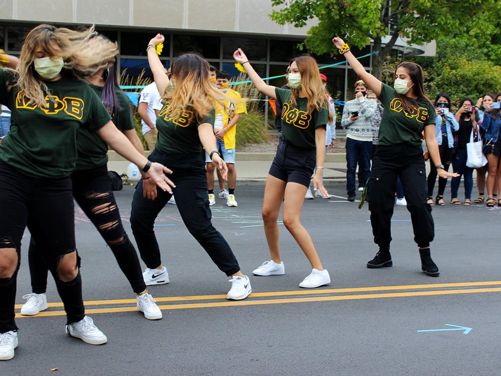 Members of the Omega Phi Beta Sorority, Incorporated perform a dance routine Sept. 26 on East Kirkwood Avenue during the 15th annual Fiesta de Otoño.